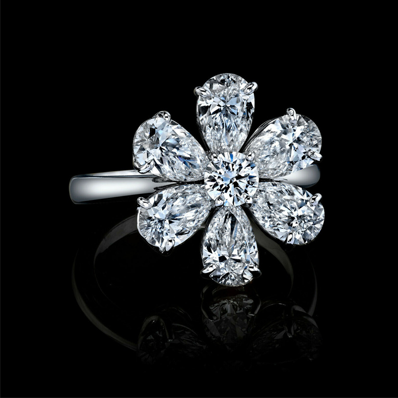 DIAMOND PEAR SHAPE AND ROUND FLOWER RING